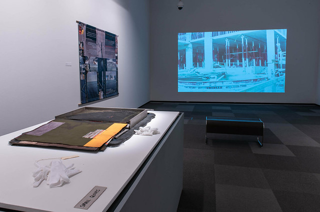 Closer Look: Investigating the Everyday (installation view, Dave Brown LCR Photo Services). Works by Sylvat Aziz and Vera Frenkel.